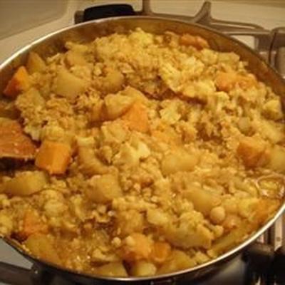 curried squash, garbanzo bean en aardappelstoofpot